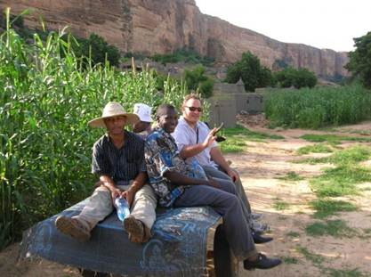 Former Country Director Mike Simsik visiting volunteer sites in Dogon country